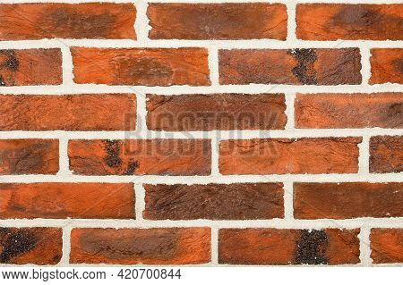The Decorative Surface Of The Wall Is Brown With A Horizontal Brown Imitation Of Brickwork With Beig