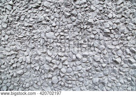 Background Of Gray Painted Relief Wall With Fine Gravel, Rough Finish. Backgrounds Design Textures.