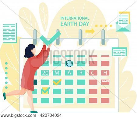 March 20 On Calendar. International Earth Day Concept. Girl Puts Mark On Calendar To Celebrate Holid