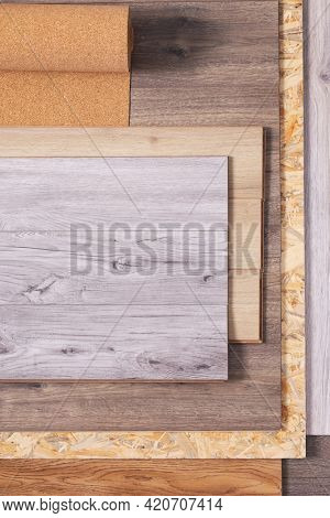 Laminate floor and cork roll on wood osb background texture. Wooden laminate floor and chipboard set with copy space