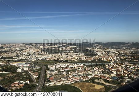 Lisbon, Portugal- March 11, 2020: Aerial View Of Lisbon Landscape From A Plane In A Clear Day Of Mar