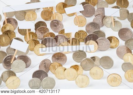 Coins At The Demonstration With Empty Posters