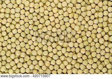 Dried Whole Peas, Background, From Above. Raw Small Spherical Seeds Of The Pod Fruit Pisum Sativum W