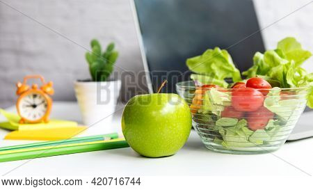 Healthy Snack With Working In Office.  Green Apple And Fresh Salad With Water For Diet Health Plan W