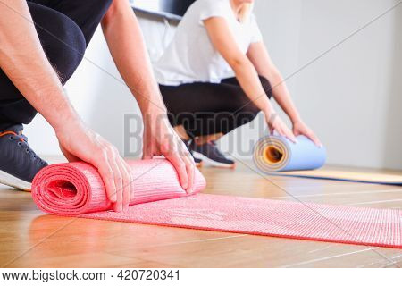 An Unrecognizable Woman And A Man In Sportswear Are Going To Do A Workout At Home. View Of The Hands