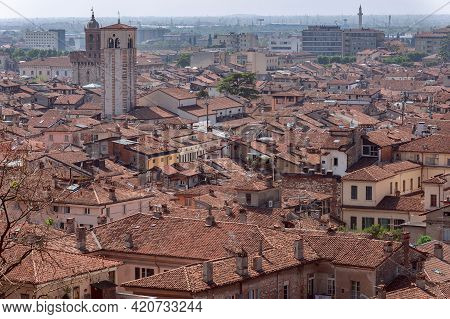 View Of The Tiled Roofs Of Ancient Houses In The Center Of Brescia (lombardy, Italy)