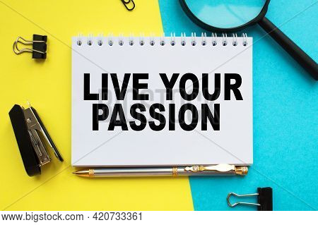 A Notepad With Text Live Your Passion On The Office Desk With Stationery. A Blank Notepad For Enteri