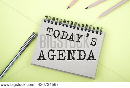 Today's Agenda Text On The Notebook With Pen On The Yellow Background