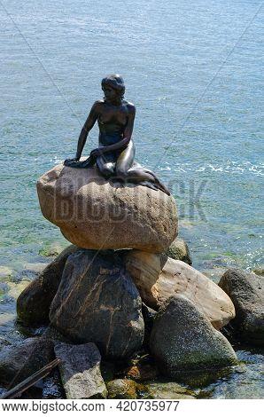 Copenhagen, Denmark - 30 April 2011: The Little Mermaid, Den Lille Havfrue, A Bronze Statue By Edvar