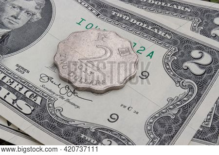 Hong Kong Dollar Coin And Us Dollar Banknote. Background With Currency. Usd Vs Hkd. Confrontation Of