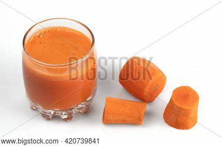 Freshly Squeezed Carrot Juice In A Glass And Slices Of Peeled Carrots. Isolated On White Background.