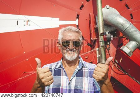 Modern Technological Farmer With Arms Folded While Smiling Satisfied