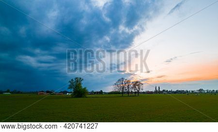 Aerial View Of An Evening Sky Over The Fields Overcast With Thunder Storm Clouds Coming In On The Su