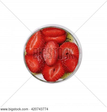 Smoothie With Slices Of Fruit And Berries Of Kiwi And Strawberry With Yogurt In A Glass. Close-up On