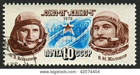 USSR - CIRCA 1976: A stamp printed in USSR shows image of Vitaly Zholobov (1937) and Boris Volynov (1934) Russian cosmonauts, circa 1976.
