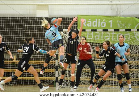 SIOFOK, HUNGARY - FEBRUARY 9: Kristina Trishchuk (blue 5) in action at a Hungarian National Championship handball match Siofok KC (black) vs. Fehervar KC (blue) February 9, 2013 in Siofok, Hungary.