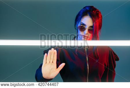 Stop Discrimination. Neon Light Portrait. Feminist Empowerment. Strict Woman In Sunglasses In Red Bl