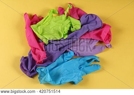 Colorful Latex Medical Gloves Pile Used As Protection Against Covid-19 Virus