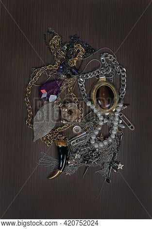 Old Fashionable Jewelry Pile On Brown Wooden Background