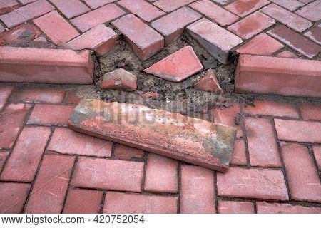 The Footpath Made Of Bricks Is Damaged.the Sidewalk Was Damaged. Damaged Brick On Pathway Pavement C