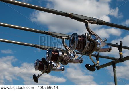 Fishing Rods With Reels On A Support System Rod Pod And Tourist Tent The Holiday Camp On The Bank.