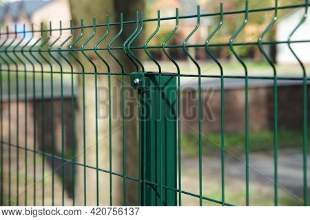 Steel Grating Fence Made With Wire On Garden Background. Sectional Fencing Installation