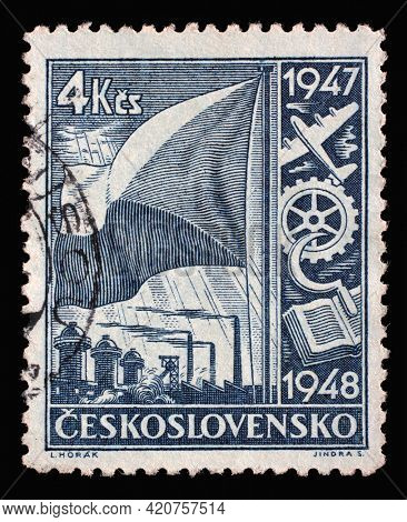 ZAGREB, CROATIA - SEPTEMBER 11, 2014: Stamp printed in Czechoslovakia shows Symbolism of the national economy, Two-year economic plan series, circa 1947