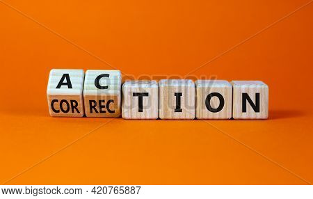 Action Or Correction Symbol. Turned Wooden Cubes And Changed The Word Correction To Action. Beautifu