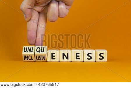 Inclusiveness And Uniqueness Symbol. Businessman Turns Wooden Cubes, Changes Words Inclusiveness To