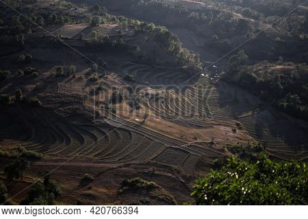 Viewpoing Looking Out Over Beautiful Terraced Rice Fields Farm Lands During Evening Sunset Between K