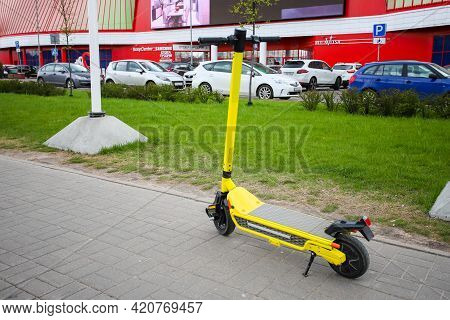 Minsk. Belarus - May 2021: Yellow Electric Kick Scooter, Scooter Rental In The City. The Scooter Is