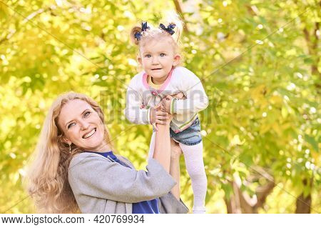 Mother With Daughter. Happy Family Portrait. Single Parent. Nature Autumn Background. Two People. Su