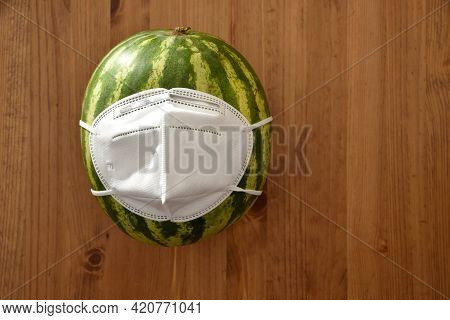 Tasty Water Melon Wrapped In Face Mask Using To Protect From Corona Virus.