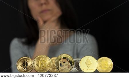 Variety Of Trending Symbolic Cryptocurrency Types Represented As Shiny Coins Are Lined Up Against Da