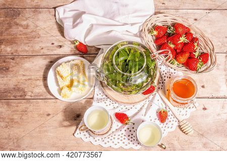 Teatime Concept With Aromatic Mint Tea, Ripe Strawberries, Sweet Honey