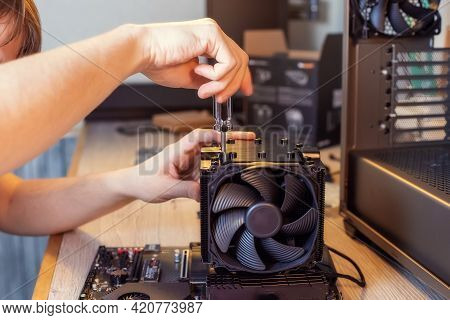Installing A Cooler On A Personal Computer Processor. The Process Of Upgrading Computer Maintenance