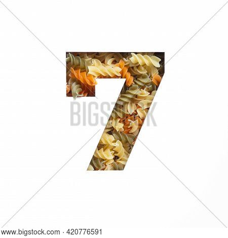 Number Seven Made Of Italian Food Fusilli Pasta, White Cut Paper In Shape Of Seventh Numeral. Typefa