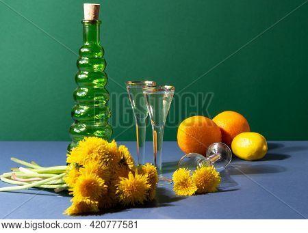 Dandelion Wine In Vintage Wineglasses. Modern Still Life With Ingredients For Preparation Herbal Mix