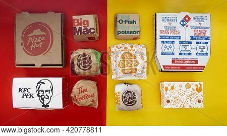 Calgary, Alberta. Canada. May 17, 2021. Several Fast Food Or Comfort Food Restaurant Chains Food Pac
