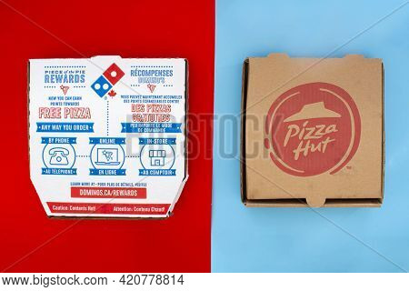 Calgary, Alberta. Canada. May 17, 2021. A Domino's And Pizza Hut Pizza Boxes. Concept: Top Pizza Com