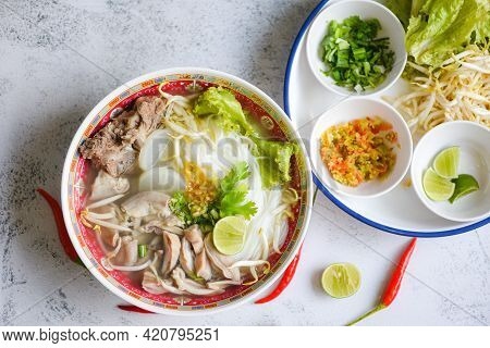 Noodle Soup Bowl, Thai Rice Vermicelli Noodle With Spicy Soup And Fresh Vegetable Set With Lemon Spr