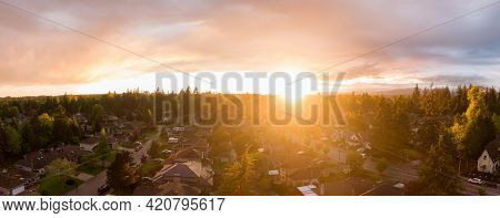 Aerial Panoramic View Of A Suburban Neighborhood During A Vibrant And Colorful Sunset. Taken In Grea
