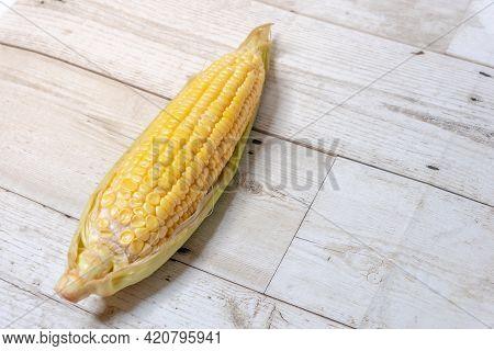 Corn On Wooden Floor, Yellow Corn On The Wood Floor, Organic Ripe Corn On Wooden Floor Of A Cottage