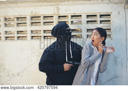 Thief Armed Man Rob Woman By Gun On Street So Scared Shocked Face. Frightened Asian Woman Was Rob Ag