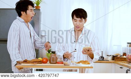 Asian Gay Couple Homosexual Cooking Together In The Kitchen Prepare Fresh Vegetable Make Organic Sal