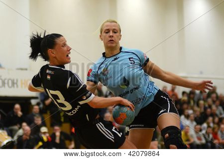 SIOFOK, HUNGARY - FEBRUARY 9: Kristina Trishchuk (R) in action at a Hungarian National Championship handball match Siofok KC (black) vs. Fehervar KC (blue), February 9, 2013 in Siofok, Hungary.