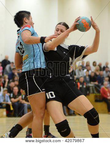 SIOFOK, HUNGARY - FEBRUARY 9: Andrea Seric (R) in action at a Hungarian National Championship handball match Siofok KC (black) vs. Fehervar KC (blue), February 9, 2013 in Siofok, Hungary.