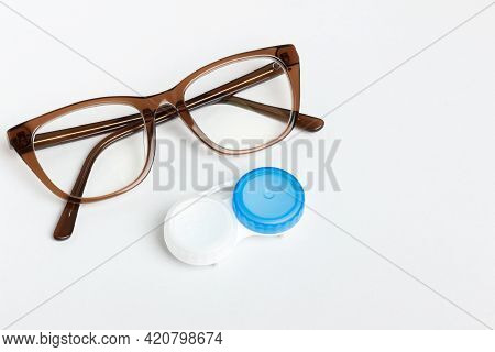 Glasses And Lenses For Vision Correction On A Colored Background, Top View. Ophthalmologist Accessor