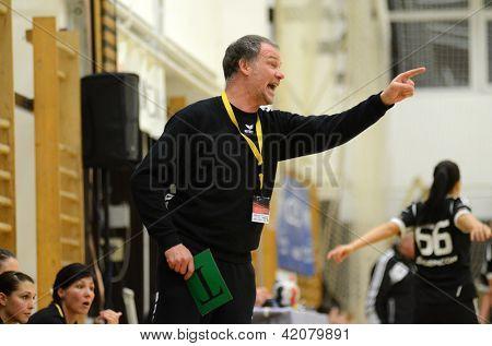 SIOFOK, HUNGARY - FEBRUARY 9: Oldrup Jelsen Fehervar trainer in action at a Hungarian National Championship handball match Siofok KC (black) vs. Fehervar KC (blue), February 9, 2013 in Siofok, Hungary.
