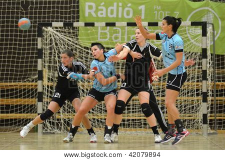 SIOFOK, HUNGARY - FEBRUARY 9: Unidentified players in action at a Hungarian National Championship handball match Siofok KC (black) vs. Fehervar KC (blue), February 9, 2013 in Siofok, Hungary.